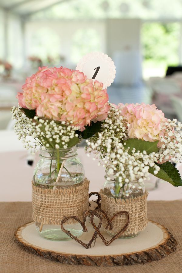 reception-centerpieces-featured-burlap-covered-mason-jars-filled-with-hydrangeas-and-babys-breath